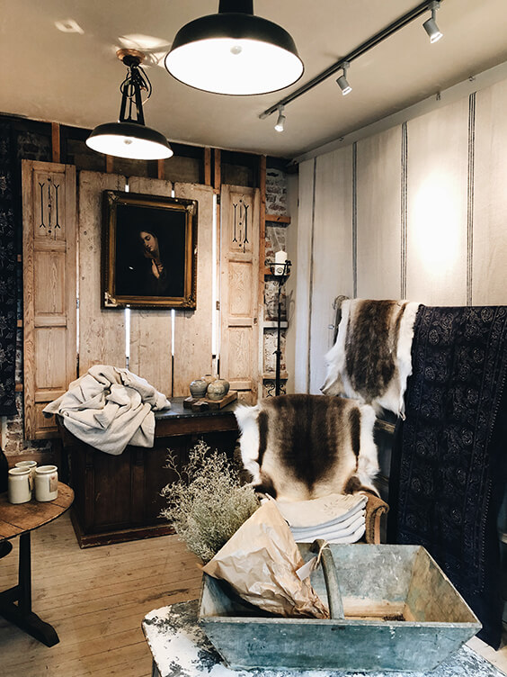 interior design with antique furniture, rugs, candles and carpets in London
