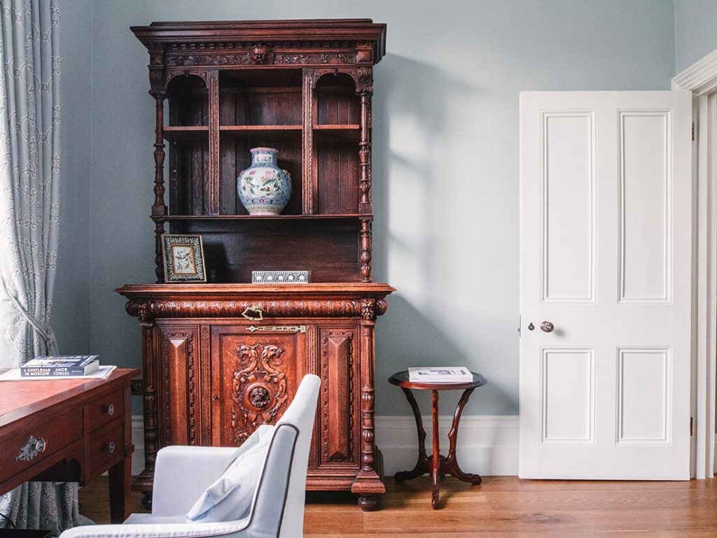 spacious home office wiith antique furniture in London