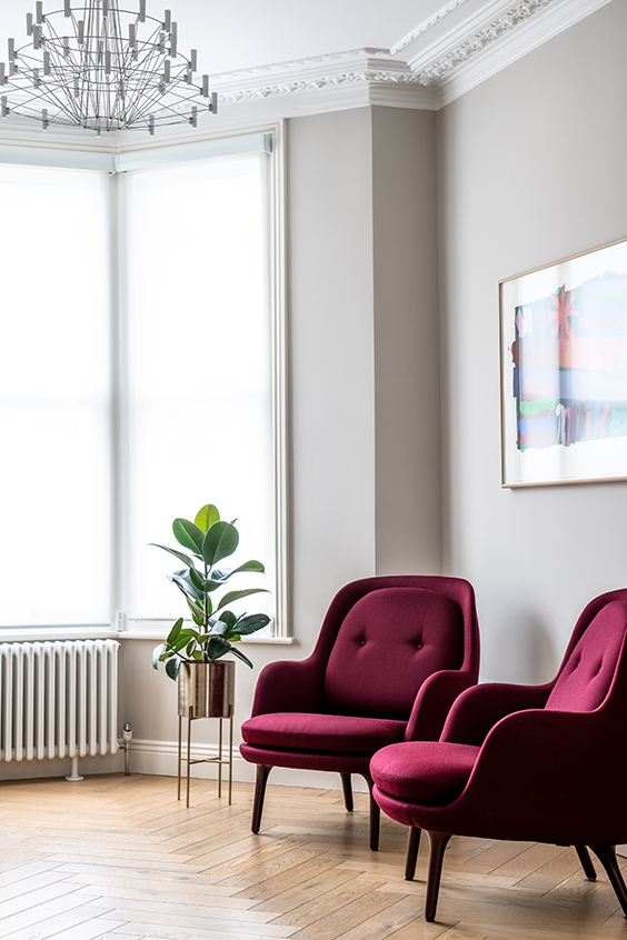 light living room with bright burgundy armchairs