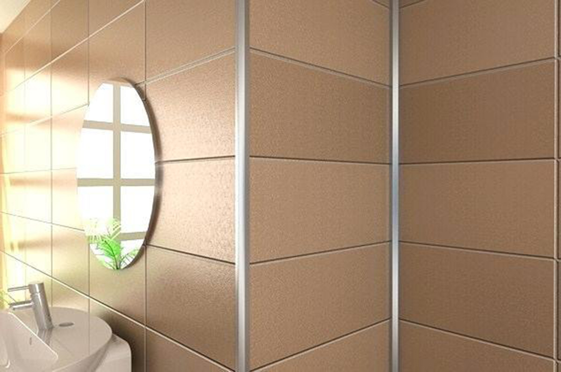 interior design for bathroom with warm colour tiles and round mirror