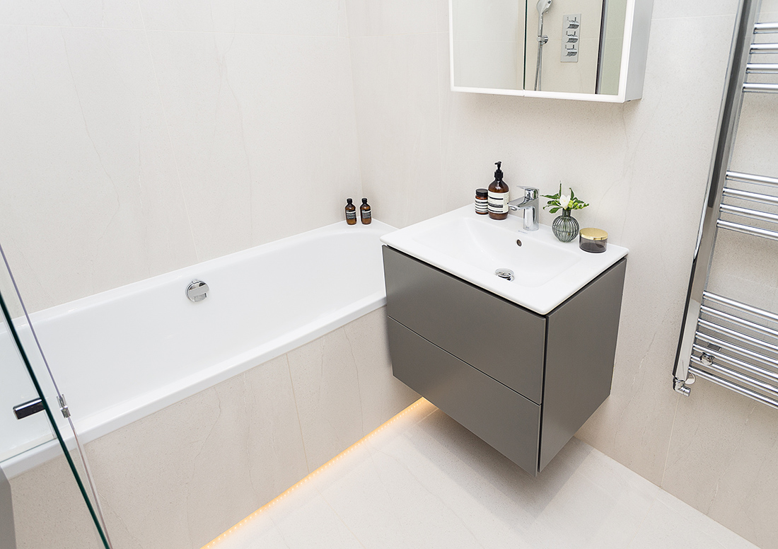 small yet practical white bathroom with built in bathtub, recessed lighting in Hampsted, london