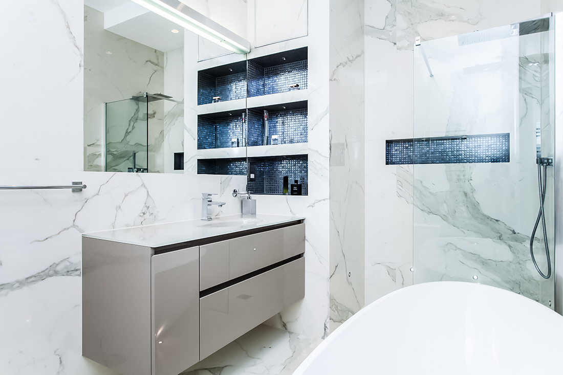 Residential interior design for spacious marble bathroom, London