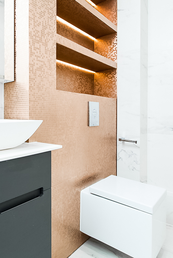 residential interior design for luxury bathroom with golden tiled walls, high-end sanitaryware, London