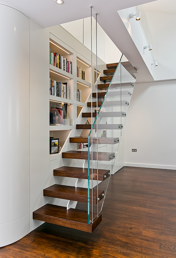 residential interior design with Matching flooring, staircase and sliding door via careful project coordination and effective use of bespoke joinery, London