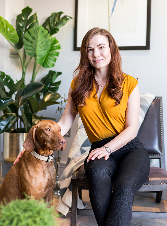 Sonia Pash, co-founder of Temza design and build studio, with Joy the vizsla, designer dog