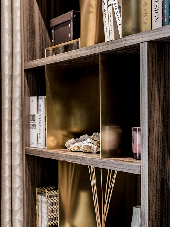 stylish brass and zebrano media unit, combining closed and open storage