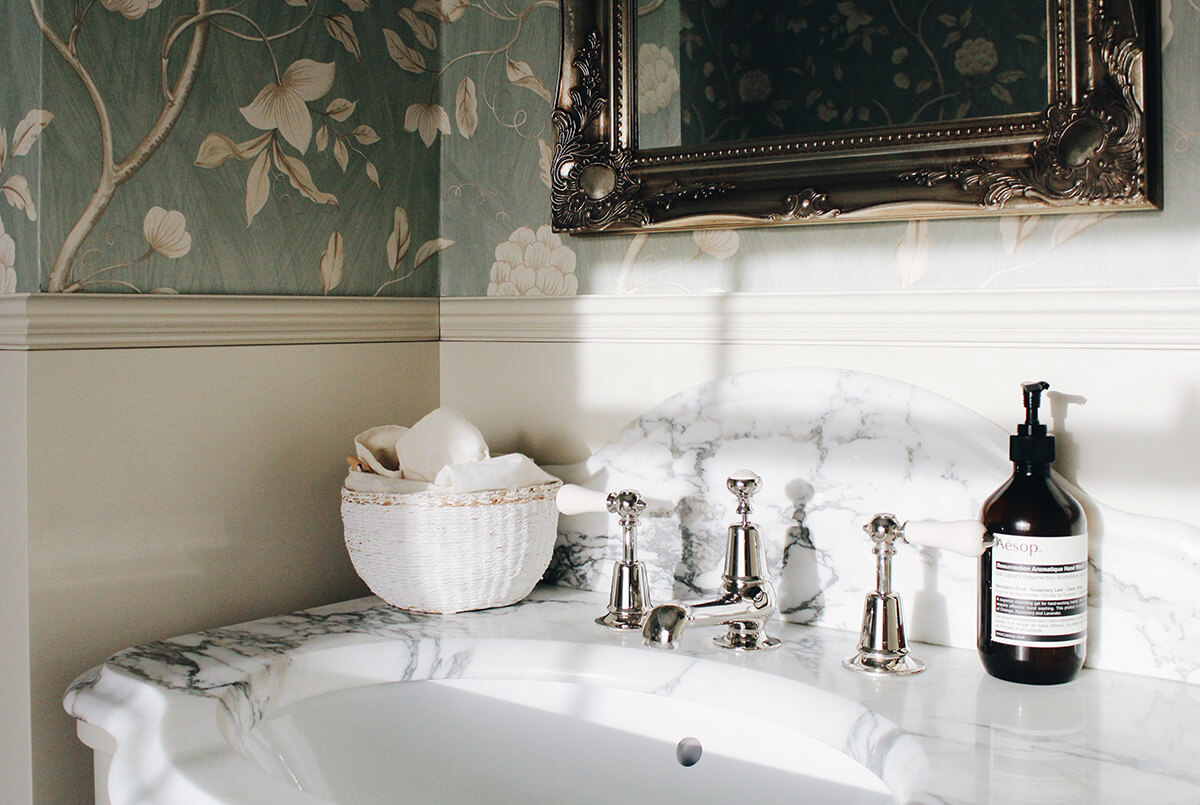 residential interior design for dreamy bathroom with soft green floral wallpapers in Grade II listed house in St John's Wood, London