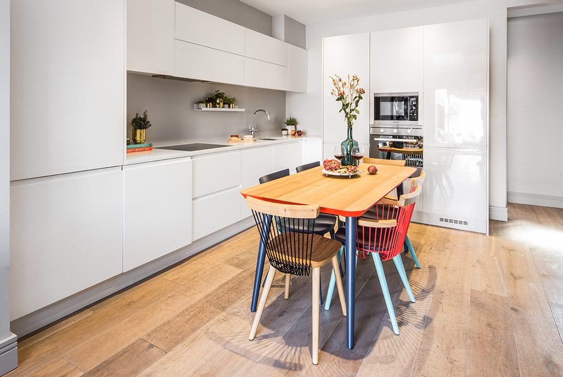 residential interior design for light open plan kitchen and living room with bright designers furniture, white bespoke cabinets and unique accessories, Shepherds Bush, london