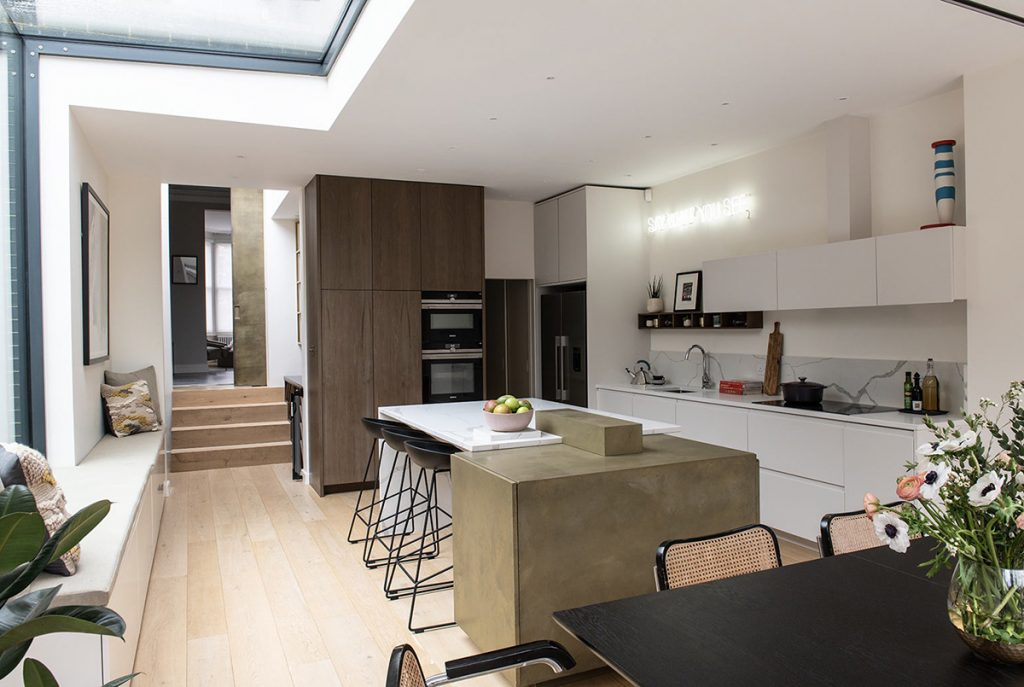 interior design and build for a spacious kitchen with bespoke joinery, white cabinets, dining area in Bromley, London
