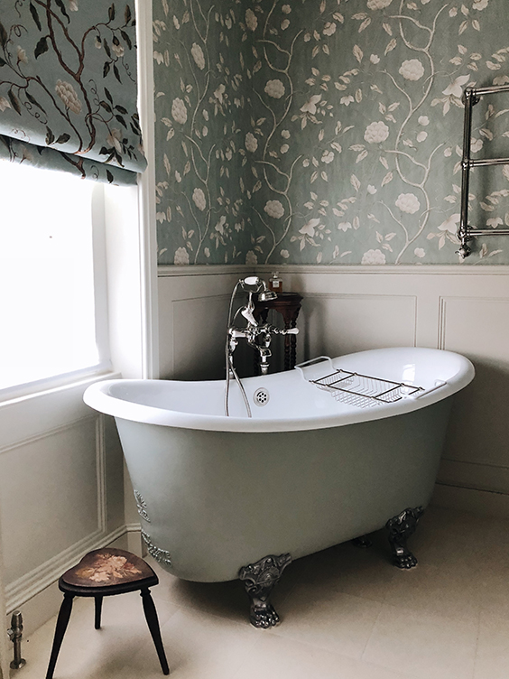 residential interior design for dreamy bathroom with soft green floral wallpapers, free standing bath on feet in Grade II listed house in St John's Wood, London
