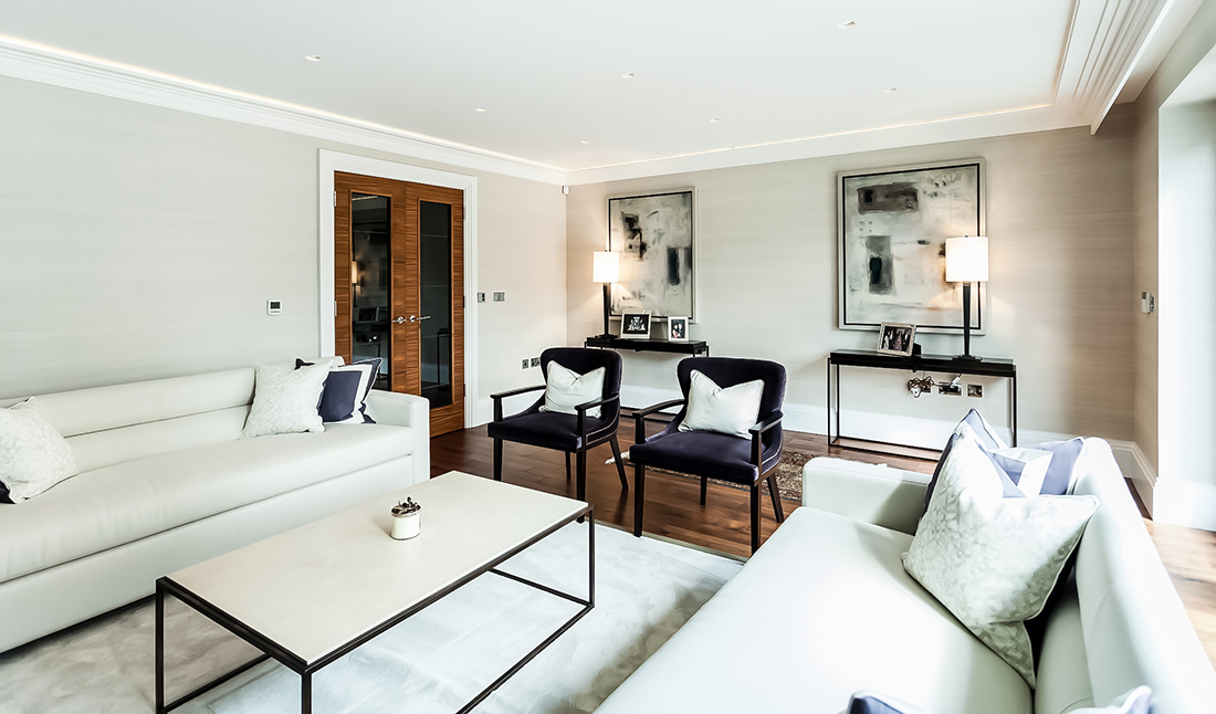 Spacious and light interior design for a living room with floor to ceiling windows, bespoke joinery and fancy interior decor in Battersea, London