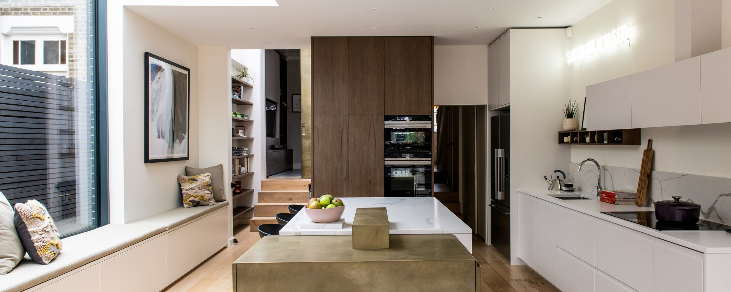 residential interior design for spacious kitchen with dining area, bespoke white cabinets, Brockley