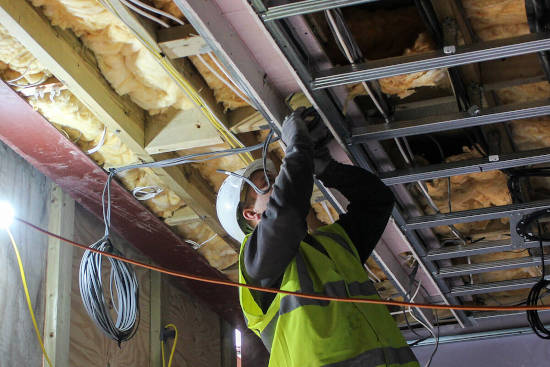 picture of a construction worker during ceiling structural alterations work